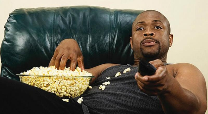 man watching tv with pop corn